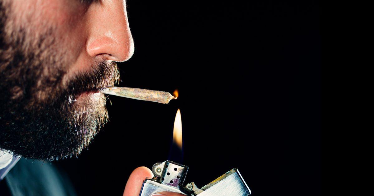 Man smoking cannabis joint